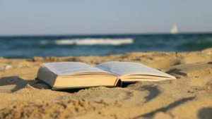 stock-footage-book-of-sand-on-the-beach